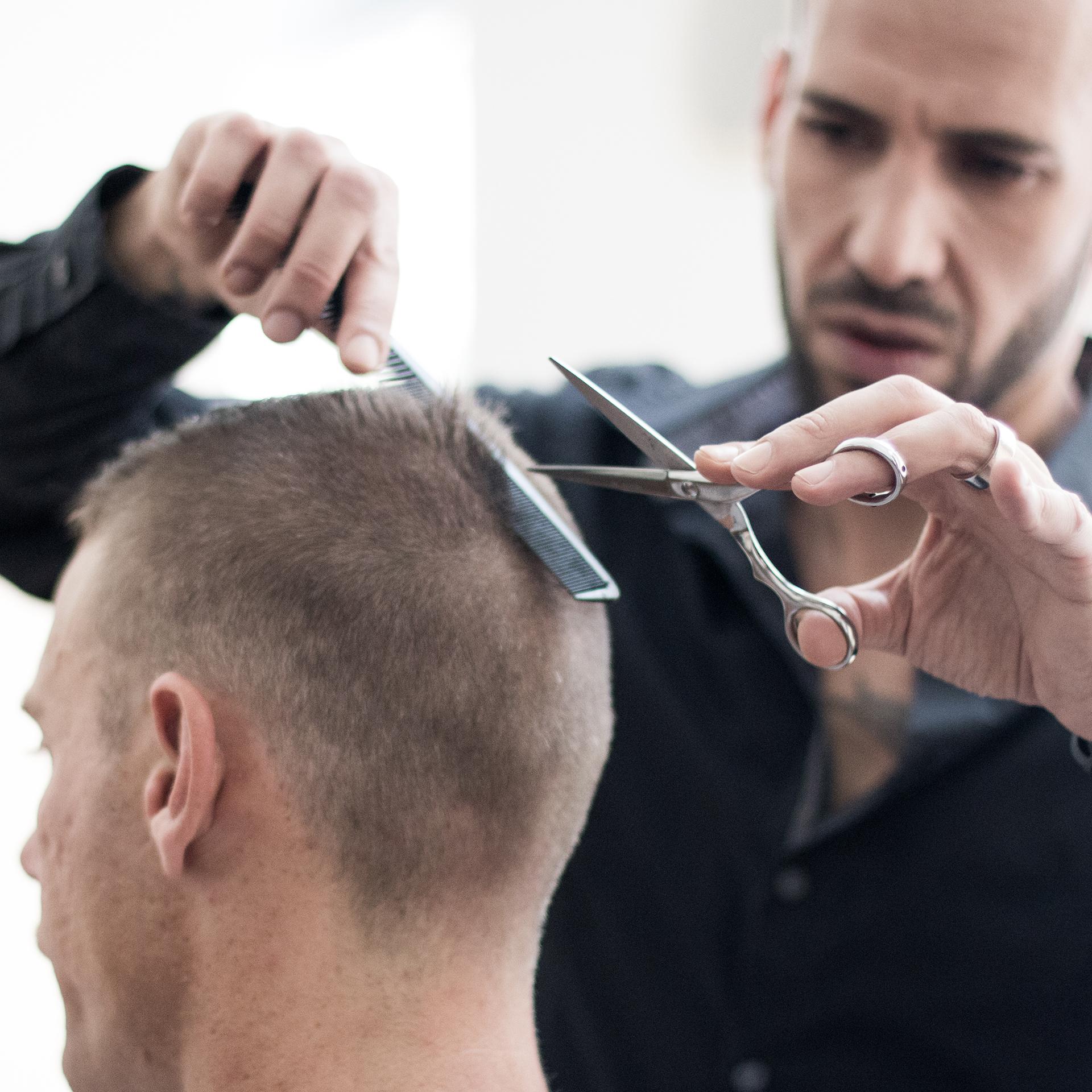 Hairdresser Yochai Mevorach with a Client